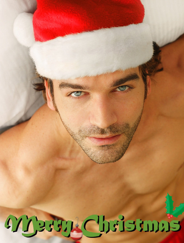 635b6d2944e41 Good looking shirtless young man in Santa Claus hat and briefs in ...